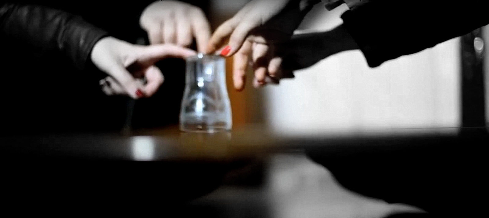 Hands on glass conducting Seance